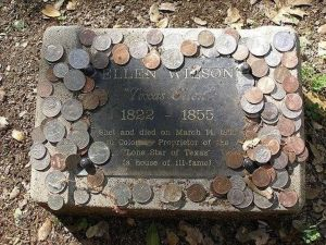 Image -veterans head stone with coins